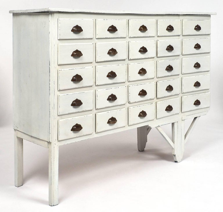 """Unique and authentic antique Haberdashery cabinet from a late 19th century """"Mercerie"""" in Lyon, France. This piece has an asymmetrical construction, probably due to the constraint of the work place, which gives it character and an interesting"""