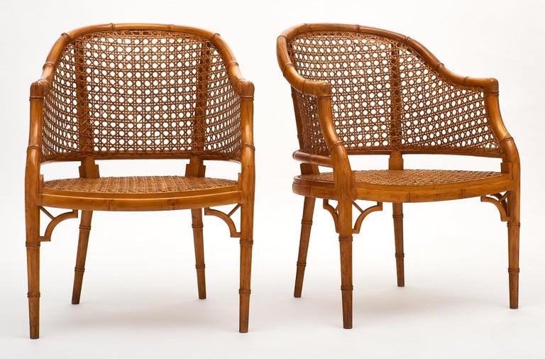Vintage French cane armchairs with bamboo frames in excellent vintage condition. We love the strong proportions and beautiful details of this pair. These chairs were purchase in Nice, the French Riviera.