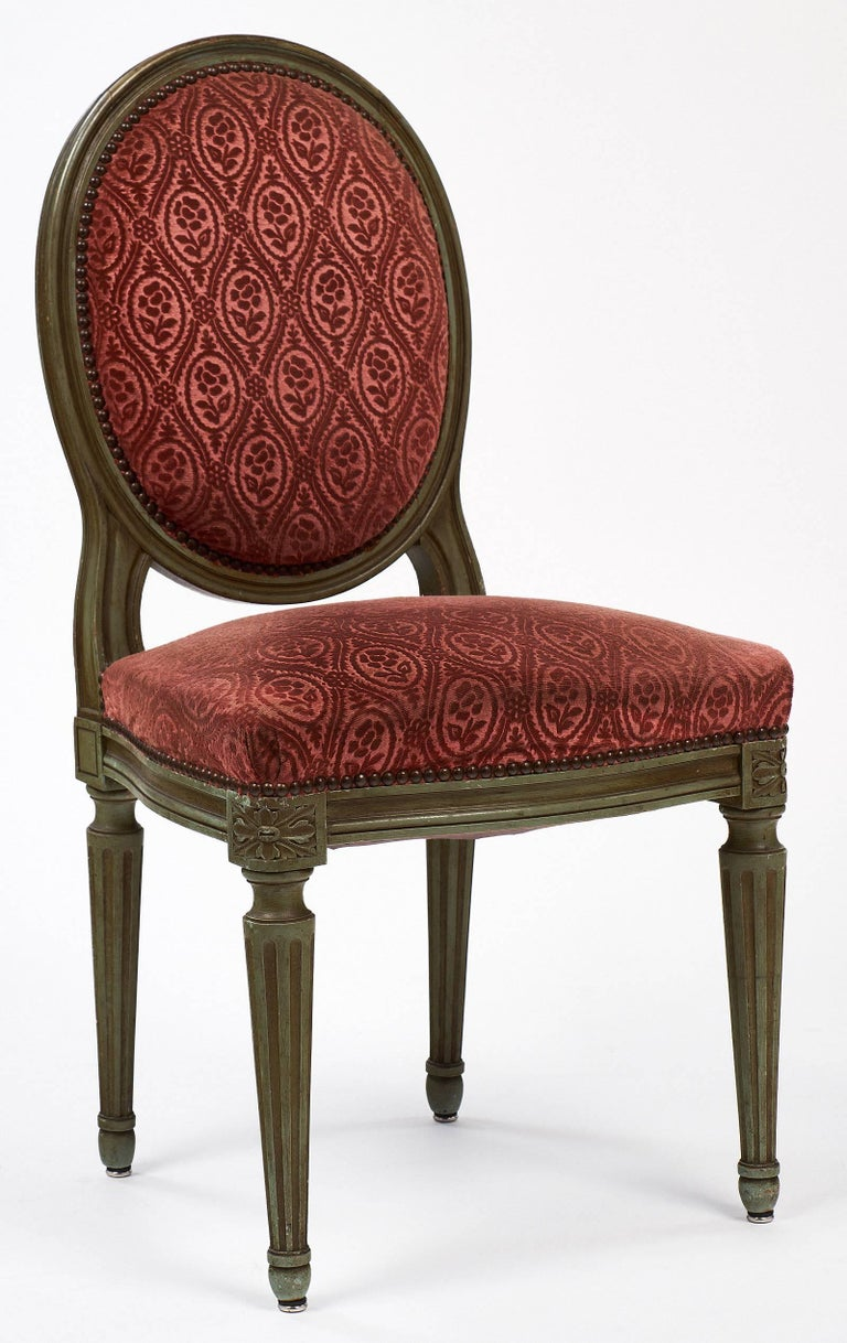 Beautiful pair of chairs with their original patinated paint finish, hand-carved beech wood frames and original stamped velvet upholstery. These chairs are very strong and comfortable. The rich terra-cotta colored fabric is in fair condition and
