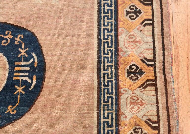 Wool Antique Khotan Rug from East Turkestan For Sale