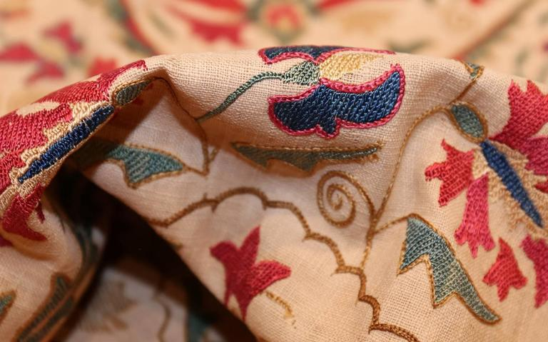 Suzani textiles and embroideries are specific styles of antique embroidered textiles produced in Kazakhstan, Tajikistan and Uzbekistan. They are embroidered and then multiple pieces are stitched together. The stitches used are primarily buttonhole,