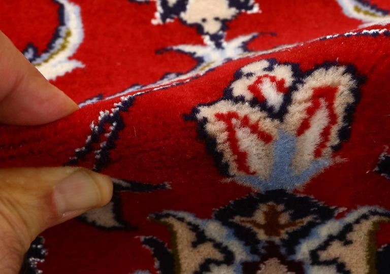 Beautiful red background vintage Isfahan Persian rug 51151, knots per square inch KPSI: 500, country of origin/rug type: Vintage persian rug, circa date: Late 20th century. Through the use of a striking volcanic palette, this vintage Persian Isfahan