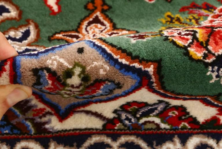 Intricate green background vintage Isfahan Persian rug 51153, knots per square inch KPSI: 500, Country of origin/rug type: Vintage Persian rug, circa Date: Late 20th century  Persian vintage Isfahan rugs – In the 17th century Isfahan emerged as