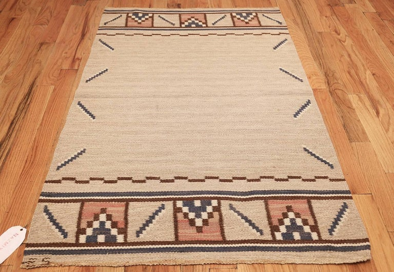 Vintage Rug by Ellen Stahlbrand, Origin: Sweden, Circa Mid 20th Century — Size: 3 ft 6 in x 5 ft 9 in (1.07 m x 1.75 m)  This charming rug by Ellen Stahlbrand uses a simple color scheme and small, blocky patterns to create a more whimsical and