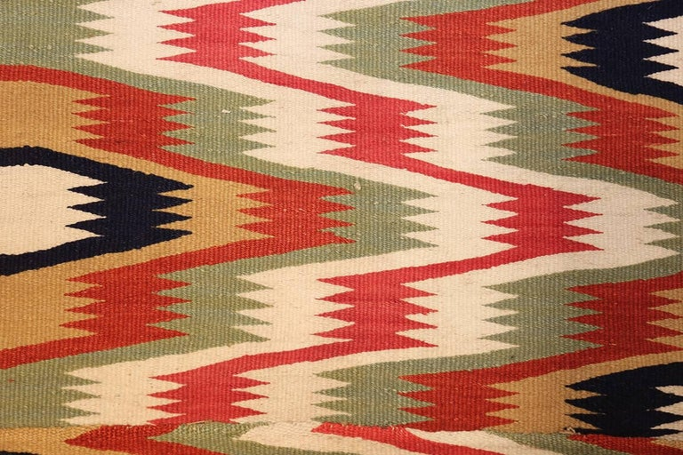 Antique Scandinavian Swedish Kilim Runner Rug, Country of Origin / Rug Type: Scandinavian Rugs, Circa Date: 1900. Size: 1 ft 9 in x 10 ft 9 in (0.53 m x 3.28 m)  Seemingly elegantly understated at first, this Swedish Kilim runner quickly becomes