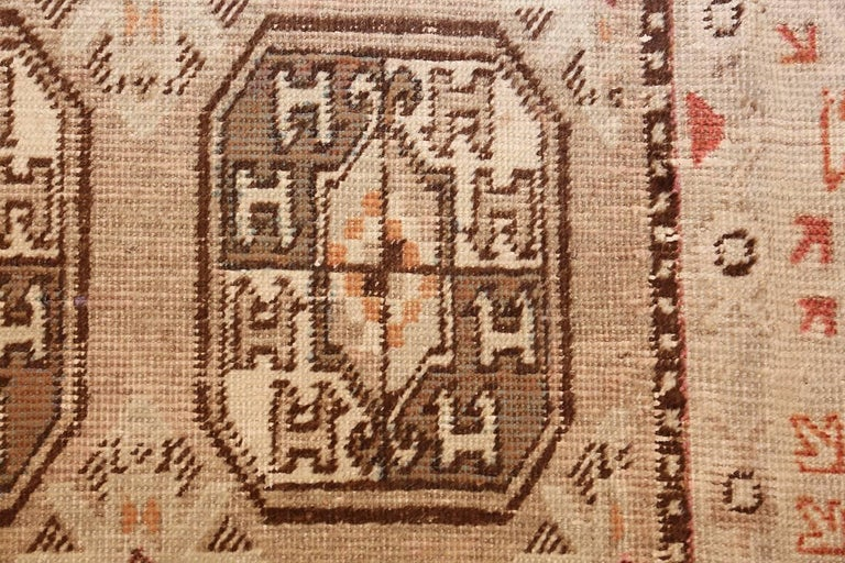 Hand-Knotted Antique Long and Narrow Oriental Khotan Rug For Sale