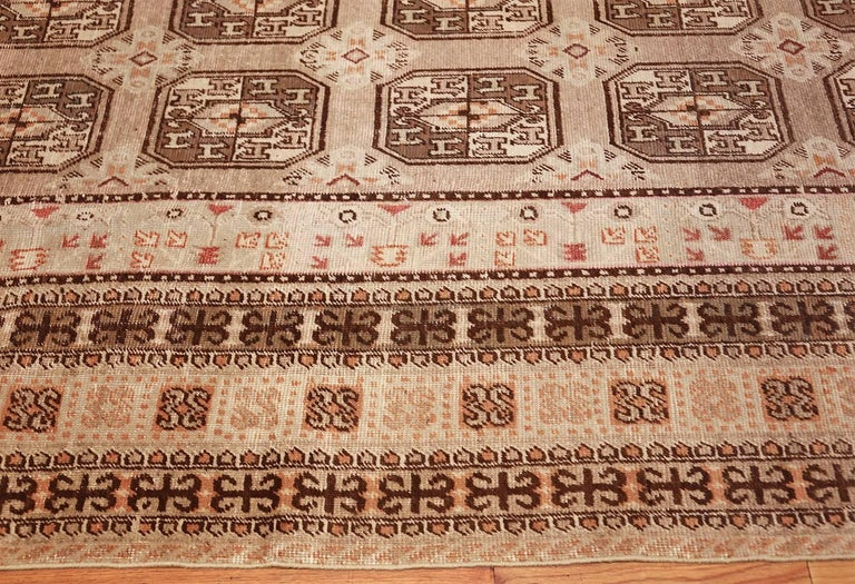 East Turkestani Antique Long and Narrow Oriental Khotan Rug For Sale