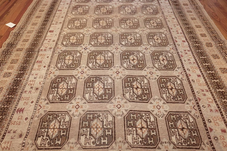 20th Century Antique Long and Narrow Oriental Khotan Rug For Sale