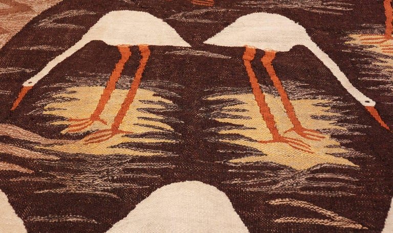 Breathtaking Naturalist Scene Vintage Scandinavian Kilim Rug, Country of Origin / Rug Type: Scandinavia Rug, Circa Date: Mid – 20th Century. Size: 5 ft 9 in x 8 ft (1.75 m x 2.44 m)  This unique vintage Scandinavian rug is truly unique. Its earthy