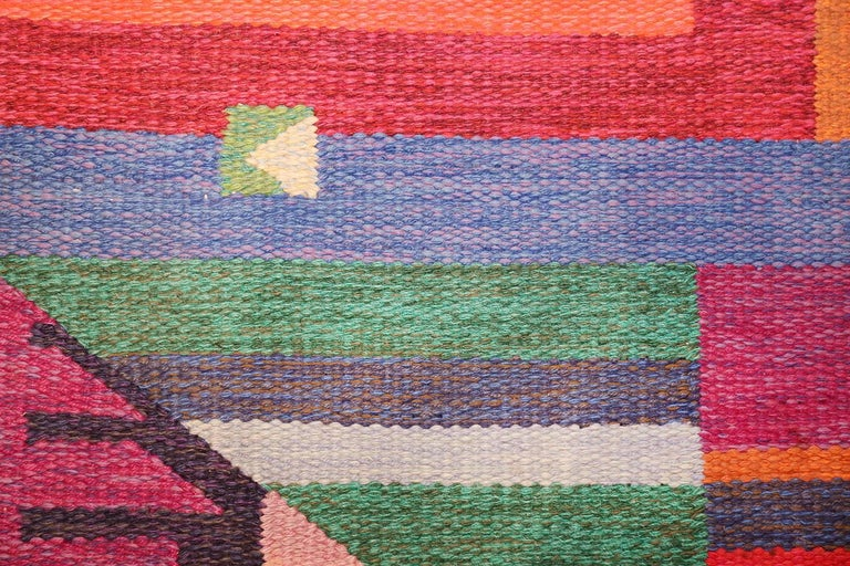 Magnificent and Colorful Vintage Scandinavian Agda Osterberg Kilim Rug, Country of Origin / Rug Type: Scandinavia Rug, Circa Date: Mid 20th Century. Size: 5 ft 5 in x 8 ft 5 in (1.65 m x 2.57 m)  This colorful vintage Scandinavian Agda Osterberg rug