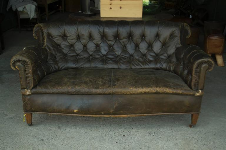 Vintage leadther Chesterfield sofa on caster. Vintage item; please see  images detail of wear - Leather Chesterfield Sofa For Sale At 1stdibs