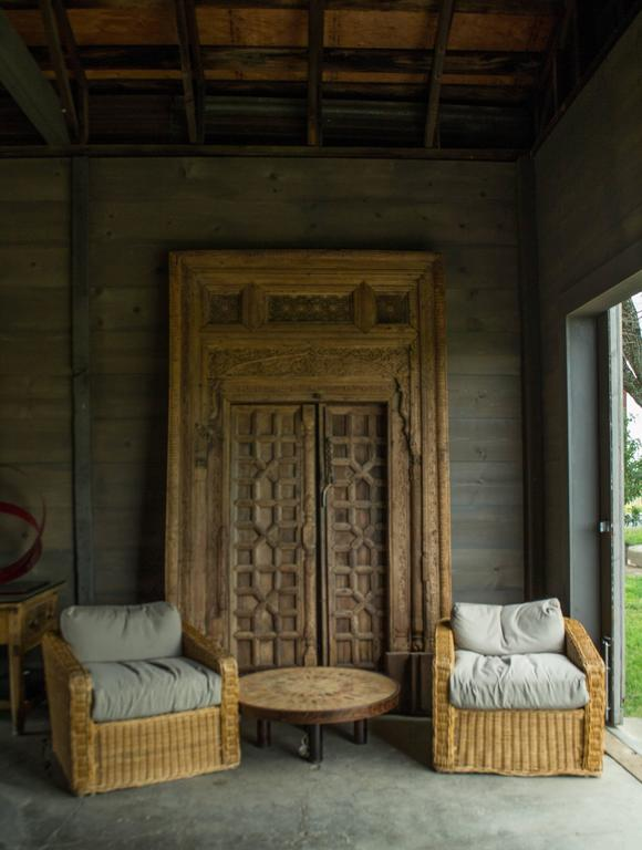 Beautifully carved Pakistani wood doors from the 17th Century. Doorway consists of 3 panels.