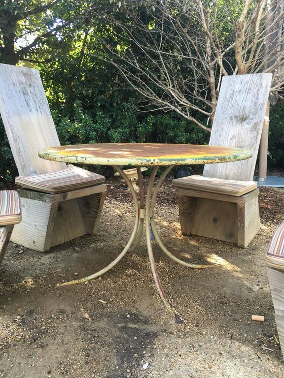 Vintage green garden table, American, circa 1940. Surface patina with multiple layers of paint revealed, including pale and dark green and warm yellow. Minor wear consistent with age and use.