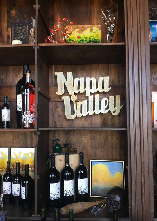 Vintage painted Napa Valley sign perfect for wine cellar or wine country decor.   Sign is sheet metal painted a cream color with patina and abrasions; please see images for a closer look at surface texture.