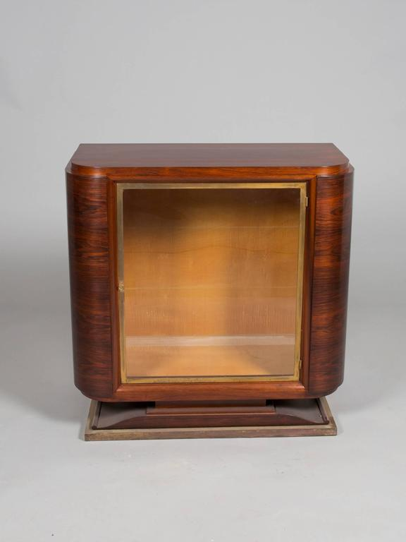 Chic Art Deco glass door cabinet with brass detailing. Glass shelves to be provided if desired.