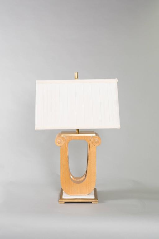 Pair of Art Deco, lyre shaped, cerused oak table lamps with marble and brass base. Shades are included.