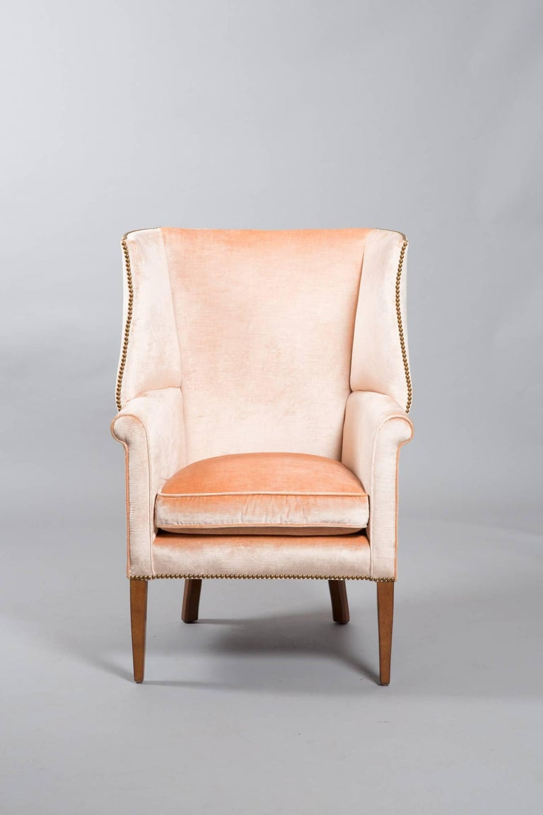 Chic 1950s American wingback armchair with apricot velvet. Great original condition.