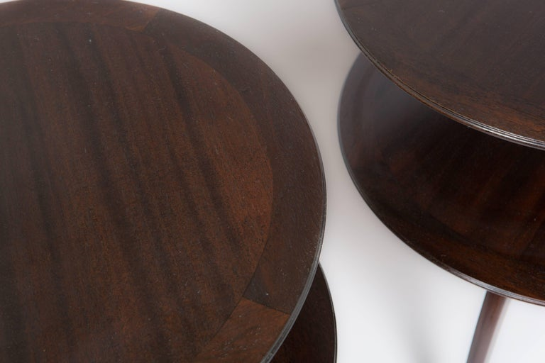 Newly restored pair of Paul Frankl for Brown Saltman two-tier occasional tables with splayed and tapered legs and espresso finish.