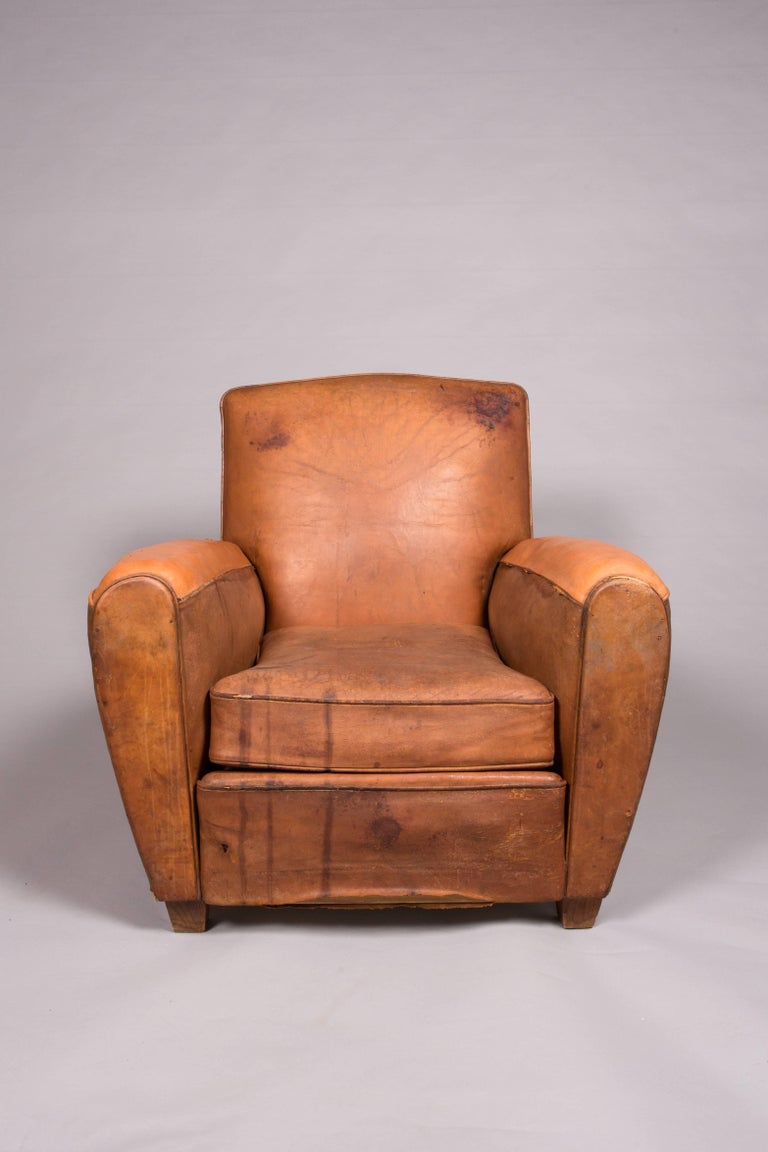 "The beat up leather chair never goes out of style! Un-replicable patina and aging. This one of a kind chair is perfect for your home office or movie set. One of a kind! 16"" seat height. 23.5"" seat depth. 20.5"" seat width. 23"" arm"