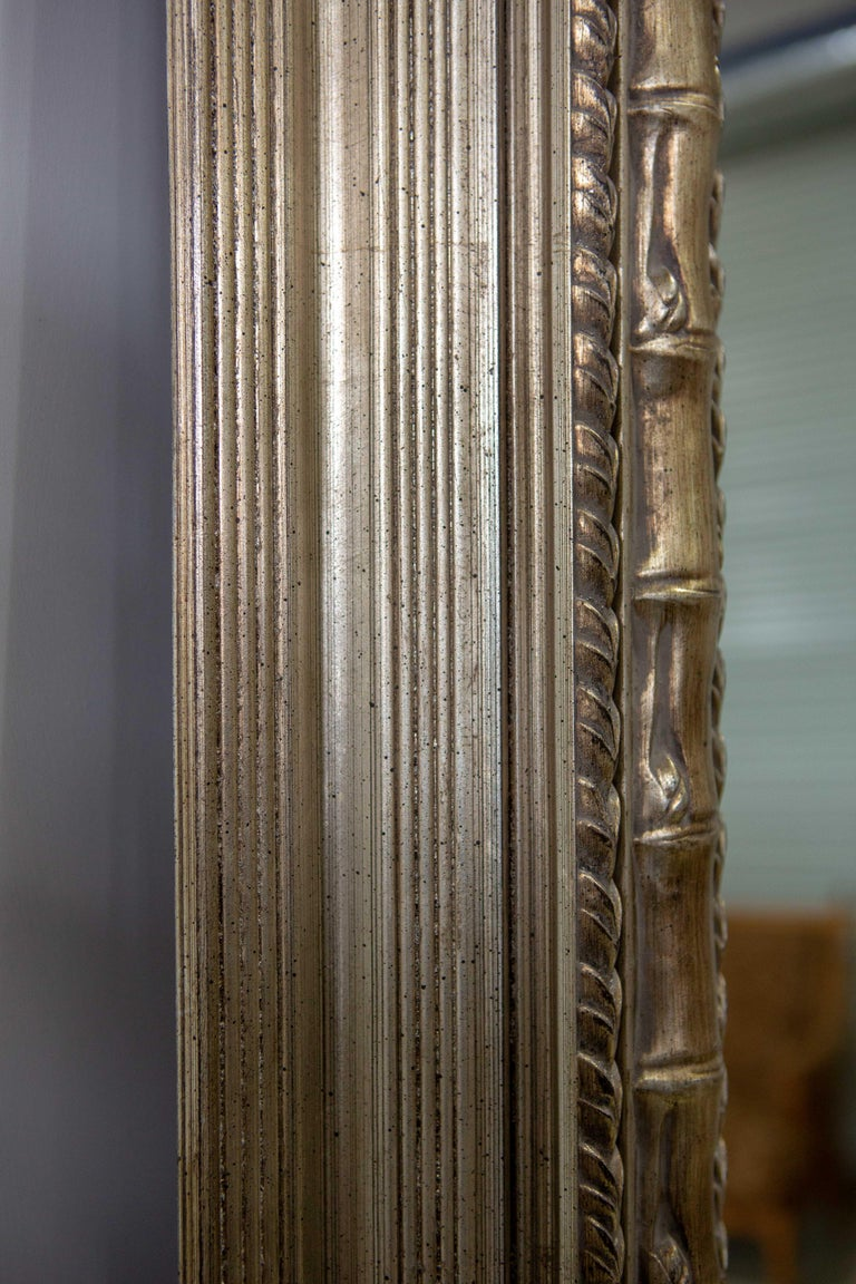 Late 20th Century Monumental Neoclassical Style Metal Mirror For Sale