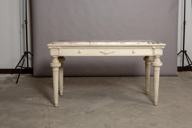 19th century French marble-top table with tapered column style legs and violet breche marble top. Beautiful variegated marble measuring 48.75