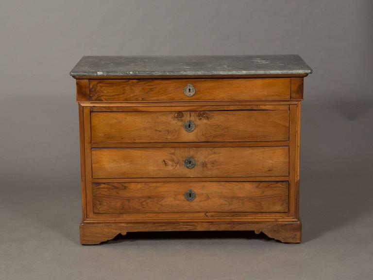 Charles X four-drawer elm commode with keys marble top and trim detail.