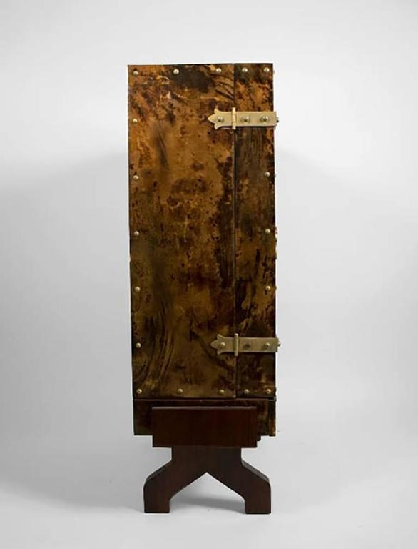 Italian 1950s lacquered goatskin bar with gilded hardware by Aldo Tura. Mirrored and illuminated interior, rosewood base.