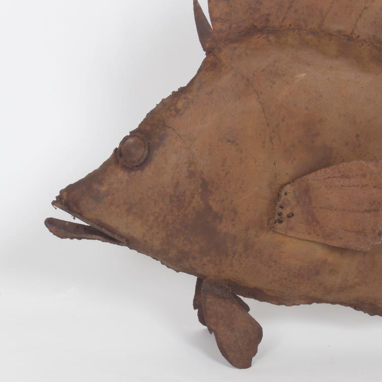 Lifesize Mid-Century metal fish sculpture of a snapper or hogfish with a rustic patina and a modern simplicity. Can be hung from a chain or sits nicely on a flat surface.  .