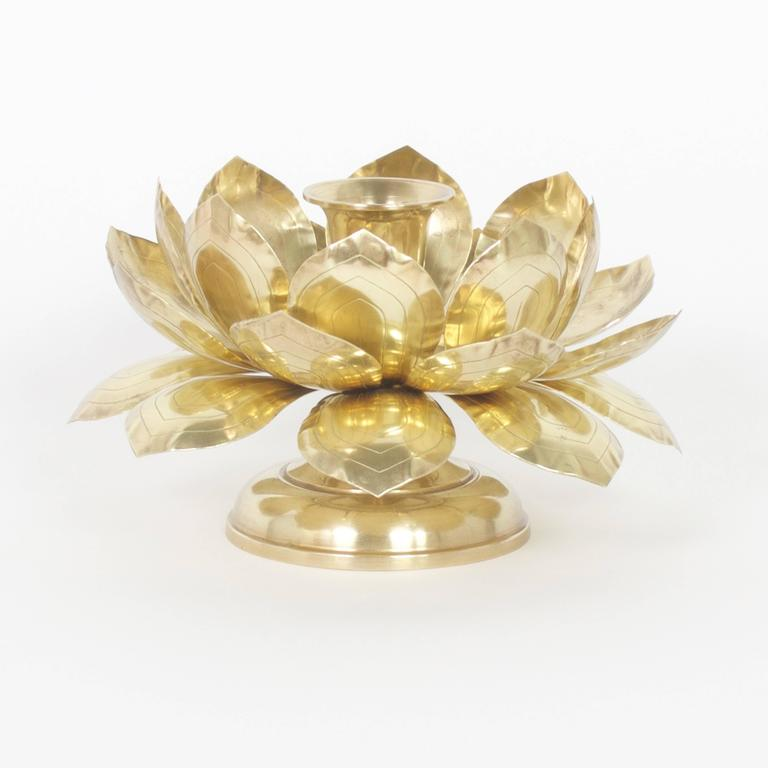 Pair of Mid-Century brass candleholders with three layers of lotus leaves over a classical turned foot, all holding a candle cup in the center. Set a romantic mood at your next intimate dinner party. Probably Feldman.   .