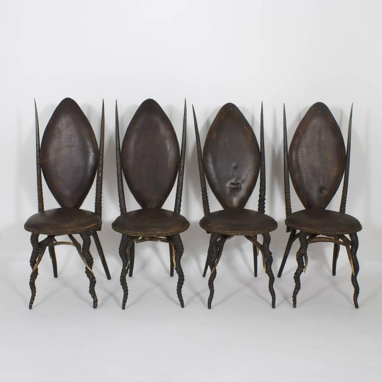 Highly unusual, exotic set of six dining chairs, complete with two arm and four side chairs. Crafted with an unlikely collection of African animal horns including Kudu, Gemsbok, and Ibex. Possibly assembled in Northern Europe where deer antlers were