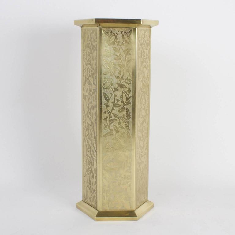 Spirited pair of brass pedestals or stands with lively hand-hammered floral patterns on all six panels. Hand polished and lacquered for easy care.