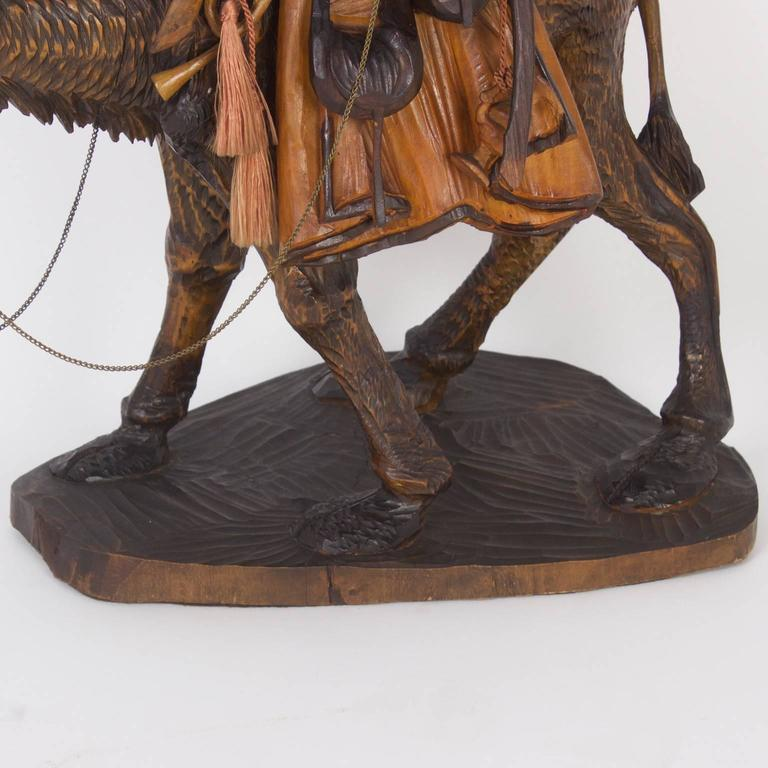 Early th carved moorish figure on a camel for sale at