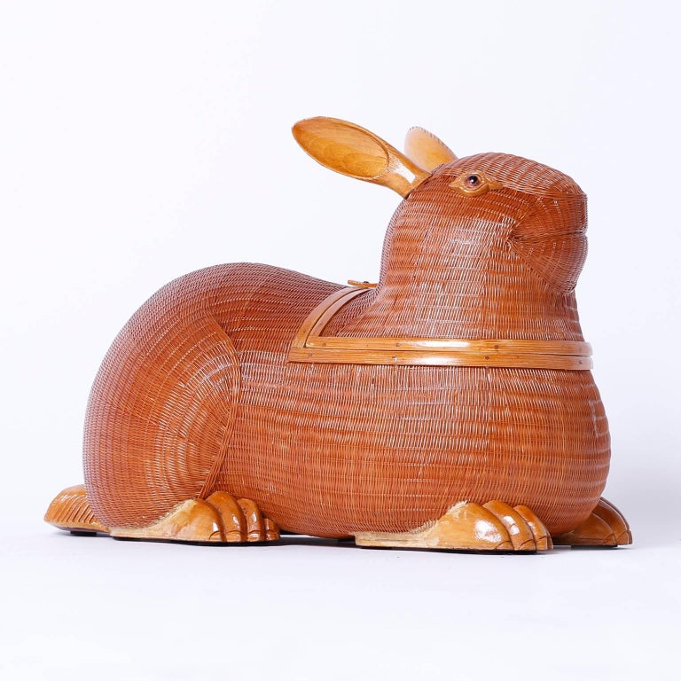 Whimsical Mid-Century wicker, wood, and rattan rabbit from the Shanghai collection with its characteristic ambitious weave that features a surprising removable lid.