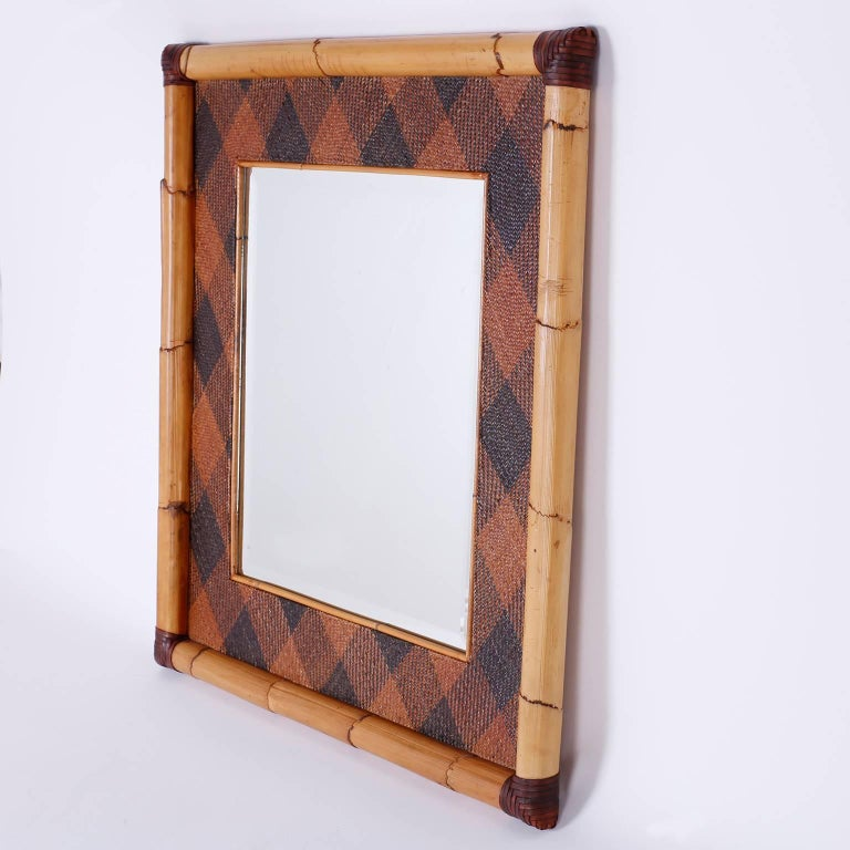 Handsome Mirror In A Frame Crafted With Bamboo And Wred At The Corners An Unusual