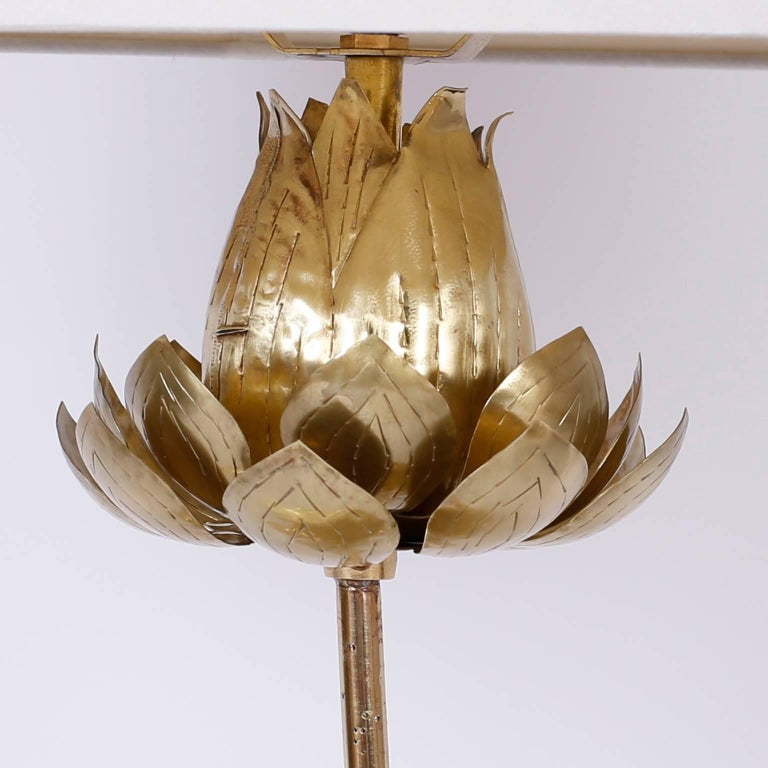 Sculptural brass table lamp depicting a lotus flower in various stages of development. Hand polished and lacquered fro easy care.