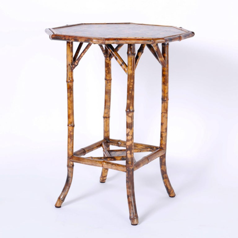 Antique English bamboo occasional table or stand with an octagon top ingeniously decorated with contemporary decoupage seashells.