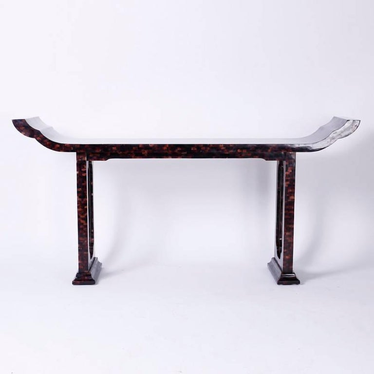 The iconic form of the Qing hall table or altar table is represented here as a modern clean version. The console is covered in a basket weave of polished seashell fragments called penshell with organic color variations that bring this timeless