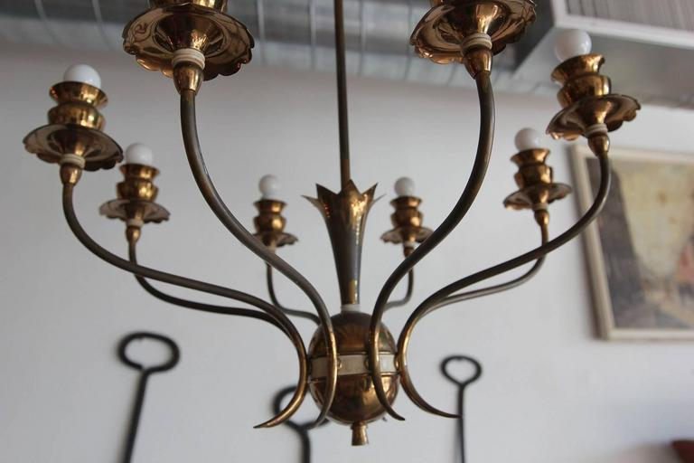 Italian brass eight-arm chandelier with fruit details.