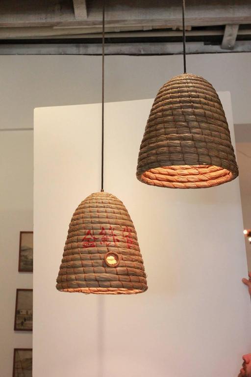 Rustic Japanese raffia beehive pendant.