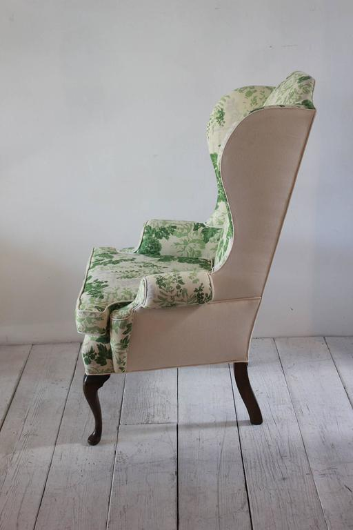 Vintage Wing Chair Upholstered In Green Floral Fabric At