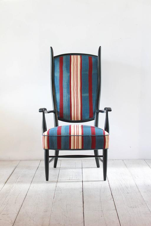 Black painted Spanish high back chair upholstered in vintage striped African fabric.