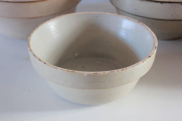 Low round German salt glazed ceramic crock. Eight available.