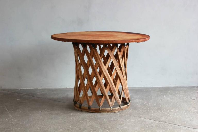 """Mexican leather wrapped round table with four Equipale chairs. Chair dimensions are: 24.5"""" W x 33"""" H x 27"""" D. Seat height is 17"""" SH."""