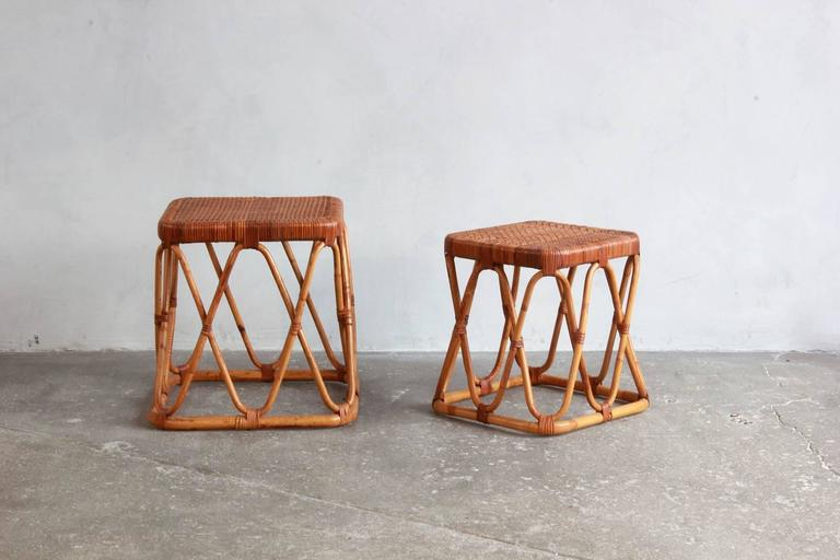 "Pair of square wicker nesting tables. Large table is: 16"" H x 14"" D, small table is 14"" H x 12"" D."