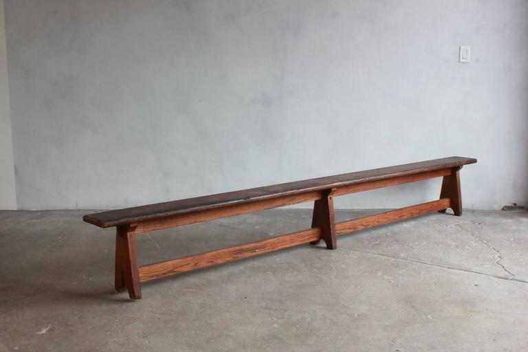 Long Rustic Bench with Middle Leg In Distressed Condition For Sale In Los Angeles, CA