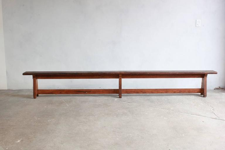 Long rustic bench with middle leg.