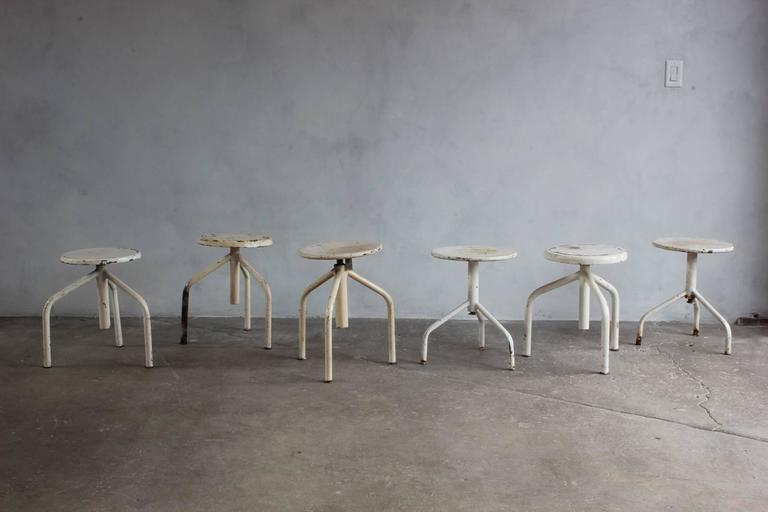 White Painted Wood and Metal Swivel Stools For Sale 5