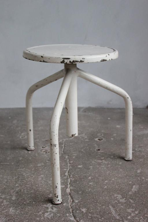 White Painted Wood and Metal Swivel Stools In Distressed Condition For Sale In Los Angeles, CA