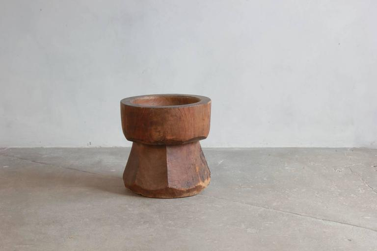 Large solid wood mortar an angular bevelled base.
