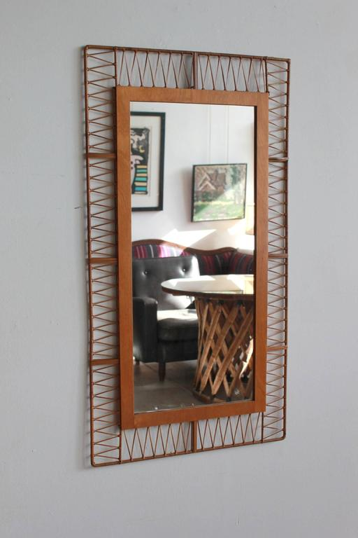 French rectangular mirror with unique rattan pattern, circa 1960s.